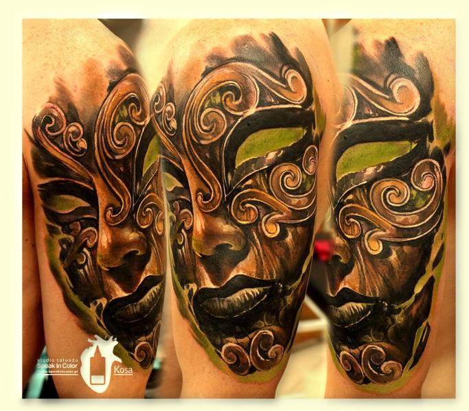 tattoo face on shoulder