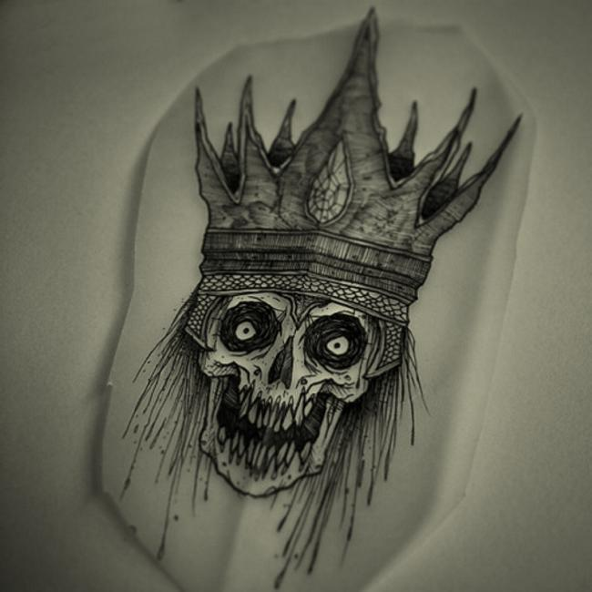 skull in crown tattoo design