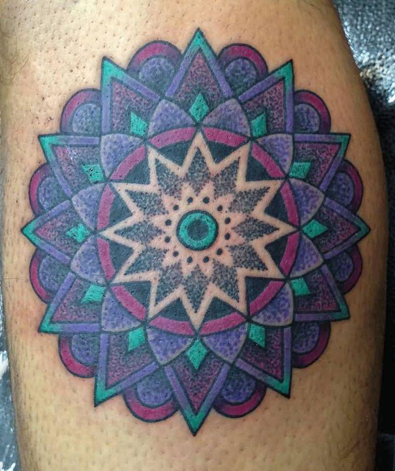 geometric tattoo on leg