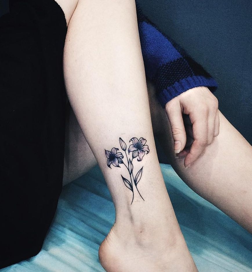 small lily tattoo on foot