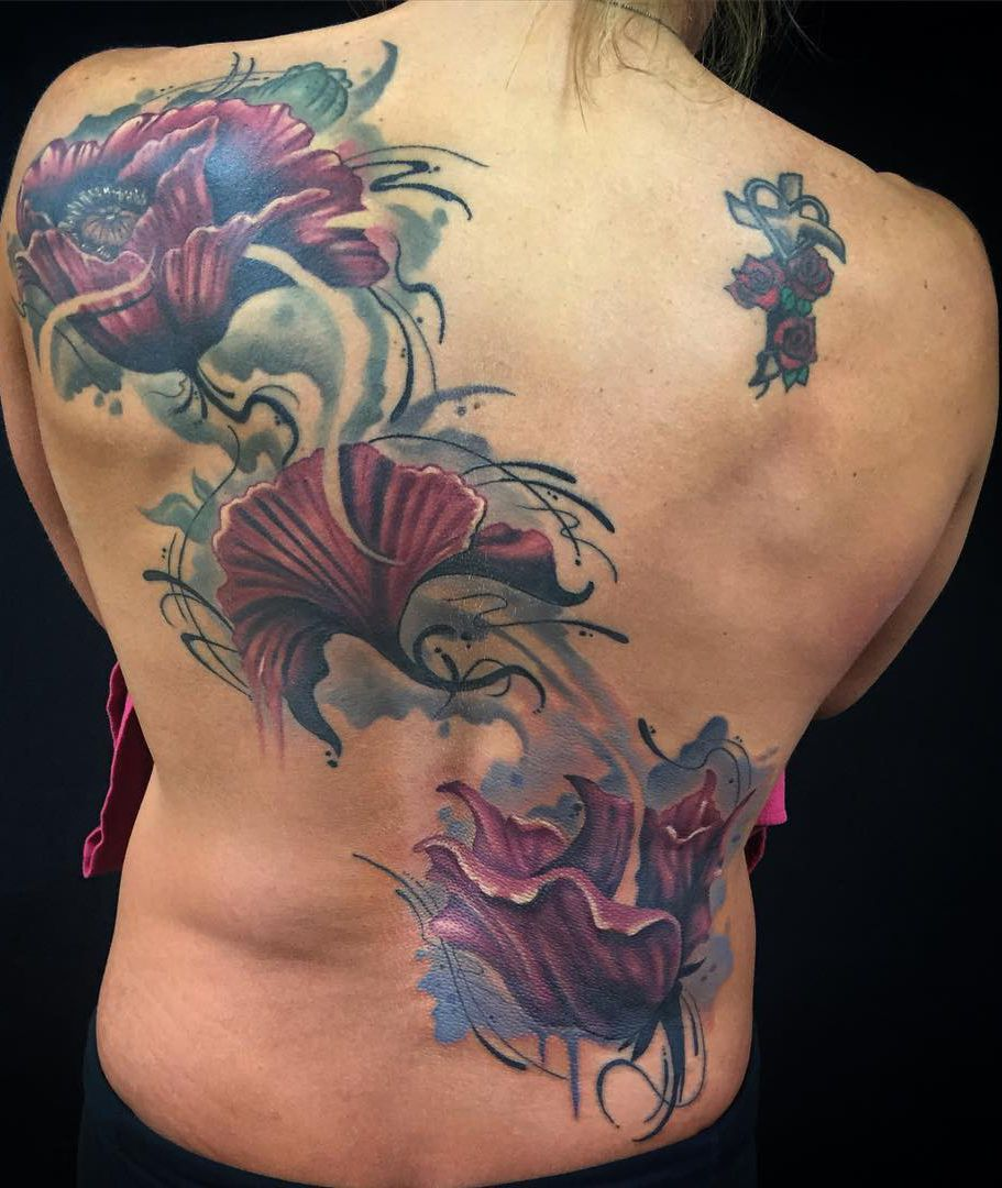 flowers tattoo on back for girl