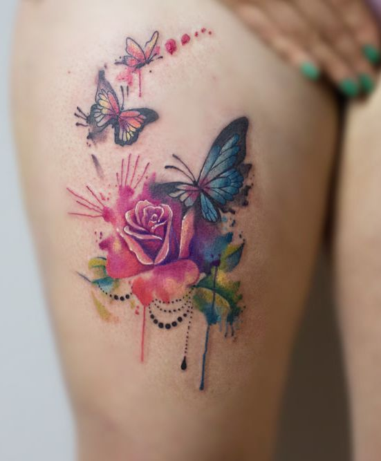 rose and butterfly tattoo on leg