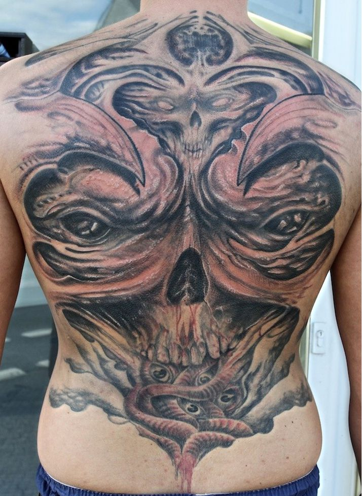 demon skull tattoo on back
