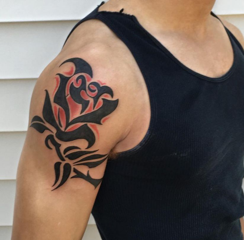dlack arm rose tattoo