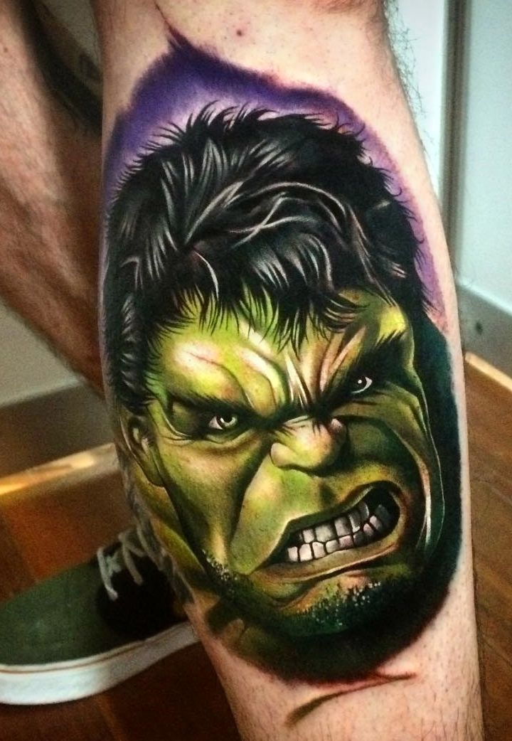 Hulk face tattoo on leg