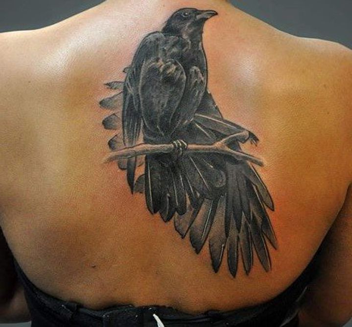 black crow tattoo on back