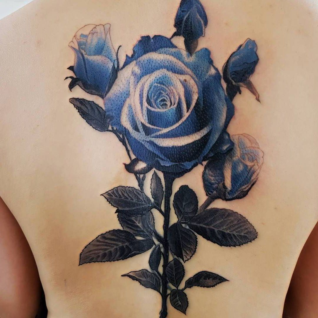 blue rose tattoo on back