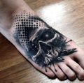 skull tattoo on foot