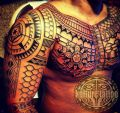 maori tattoo on chest and arm
