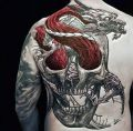 dragon and skull on back | tattoo