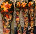 flowers and skull sleeve tattoo